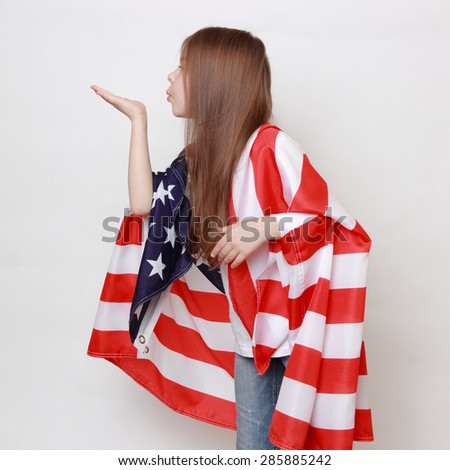 Little girl and American flag - stock photo