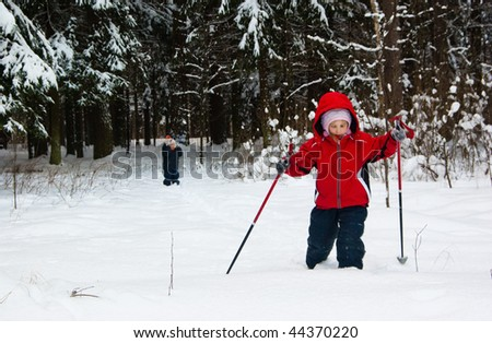 Little Girl and Boy Cross Country Skiing. Making a Ski Track. - stock photo