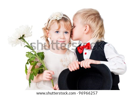 little girl and boy first kiss isolated on white - stock photo