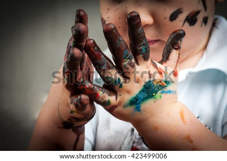 Little girl and boy hands painted in colorful paints - stock photo