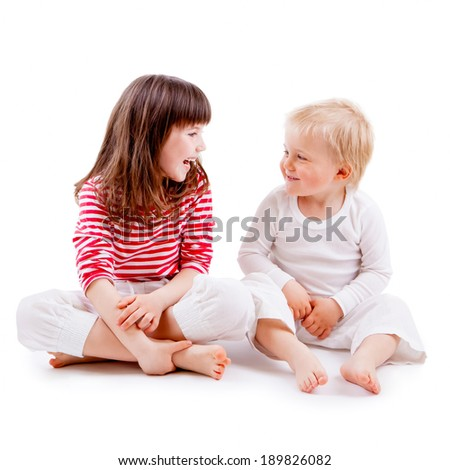 LITTLE GIRL AND BOY ON WHITE BACKGROUND - stock photo