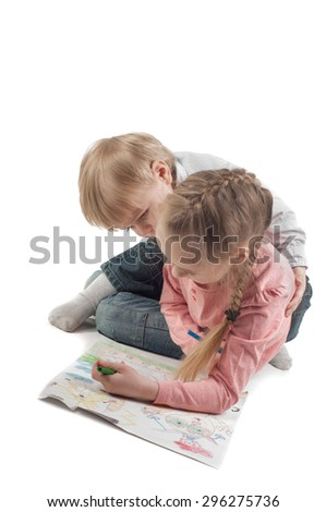 Little girl and boy painting. Shallow depth of field - stock photo