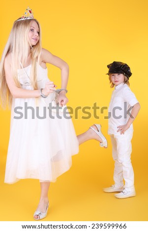 little girl and boy playing princess and policeman