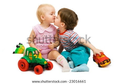 Little girl and boy playing together. Isolated on white background - stock photo