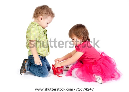 little girl and boy with gift - stock photo