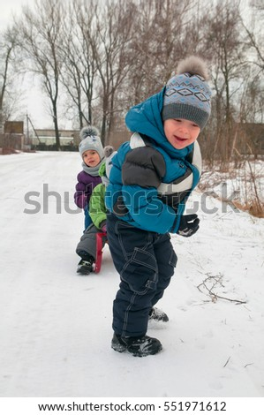 little girl and boys enjoying sleigh ride