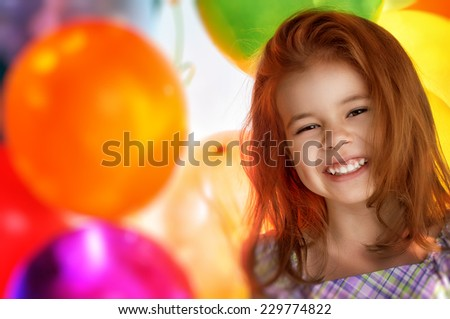 little girl and color balloons - stock photo