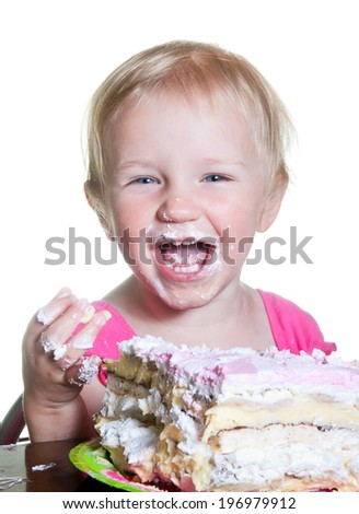 little girl and her birthday cake - stock photo