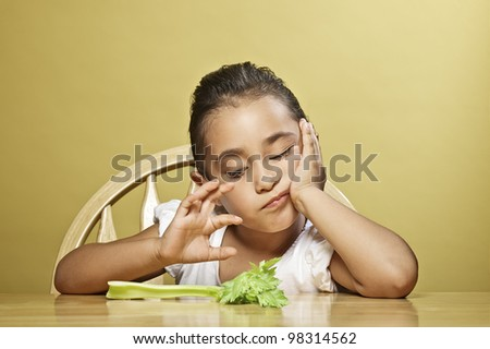 Little girl and her nutritious snack - stock photo