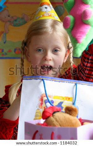 Little girl and her present - stock photo