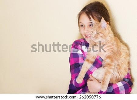 little girl and kitten looking sideways - stock photo
