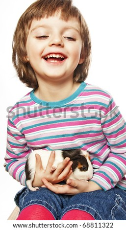 little girl and pet guinea pig - stock photo