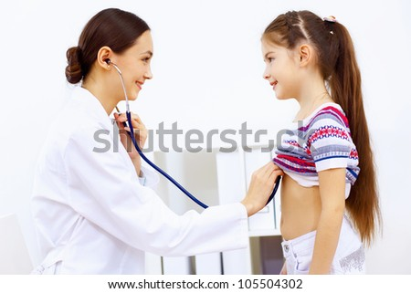 Little girl and young doctor in hospital having examination
