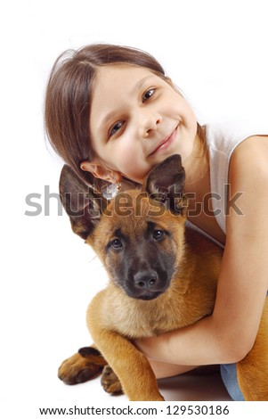Little girl and young puppy belgian shepherd malinois isolated on white - stock photo