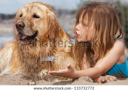 little girl arguing with her dog - stock photo