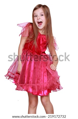 little girl as butterfly isolated on Holiday theme/Smiling little blond girl showing her pink carnival costume. Isolated on white - stock photo