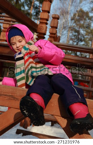 little girl at playground in winter outdoor Zelenograd, Moscow, Russia - stock photo