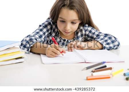 Little girl at school making drawings and painting - stock photo