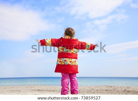 Little girl at the beach. - stock photo