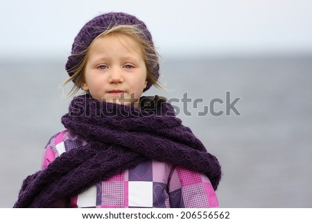 little girl at the cold beach