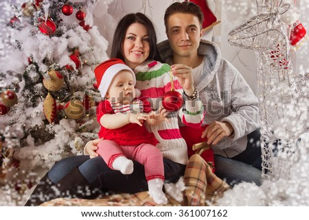 Little girl, baby in Christmas interior - stock photo