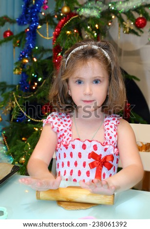 Little girl baking Christmas cookies at home  - stock photo