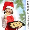 little girl baking Christmas cookies - white background - stock photo
