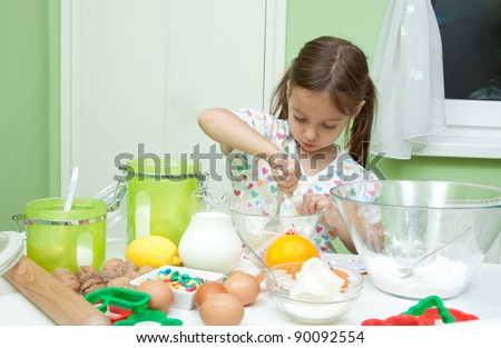 little girl baking in the kitchen, delicious cookie - stock photo