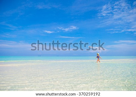 Little girl beach vacation - stock photo
