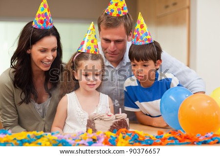 Little girl blew out the candles on her birthday cake - stock photo