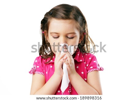 Little girl blowing her nose in tissue, cold, flu or hygiene concept - stock photo