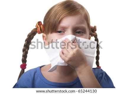 Little girl blowing nose in tissue isolated over white background - stock photo