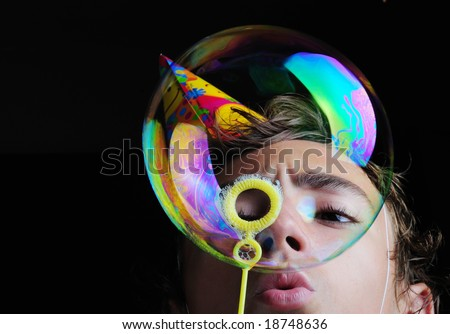 Little girl blowing soap bubbles, children birthday party - stock photo