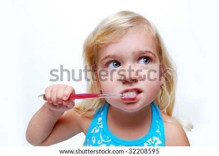 little girl brushing teeth - stock photo