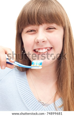 little girl brushing teeth with manual toothbrush, isolated on white