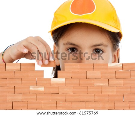 little girl building a wall isolates on white background - stock photo