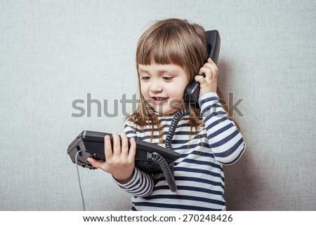 Little girl calling phone - stock photo