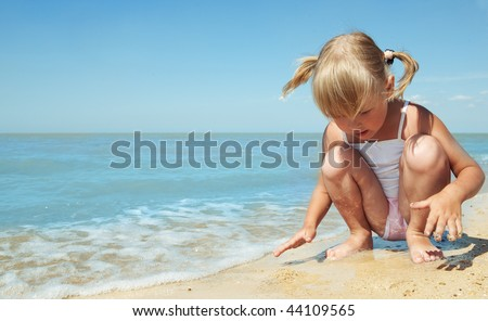 little girl child on the sea under blue sky - stock photo