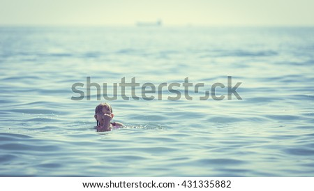Little girl child swimming in ocean. Kid and woman bathing in sea water. Summer vacation holiday relax. - stock photo