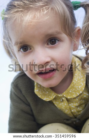 Little girl close-up outdoors - stock photo