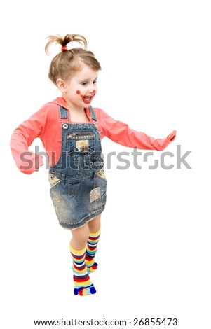 Little girl clown dancing happily - stock photo