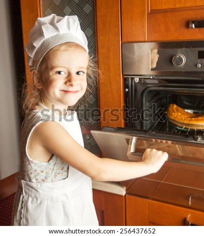 little girl cook at home - stock photo
