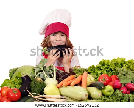little girl cook with aubergine and vegetables