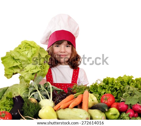 little girl cook with green salad and vegetables