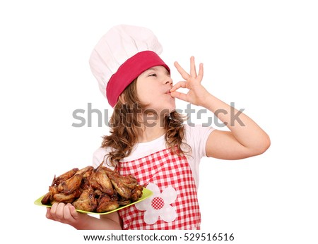 little girl cook with roasted chicken wings and ok hand sign