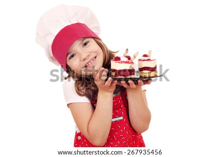 little girl cook with sweet raspberry cake - stock photo