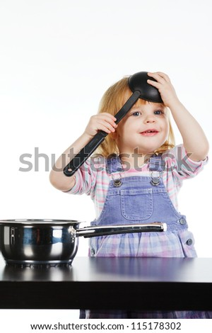 little girl cooks - stock photo