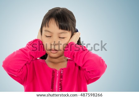 Little girl covering the ears