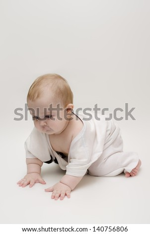 Little girl crawling on the floor hard