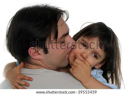 Little girl crying on her father's shoulder - stock photo